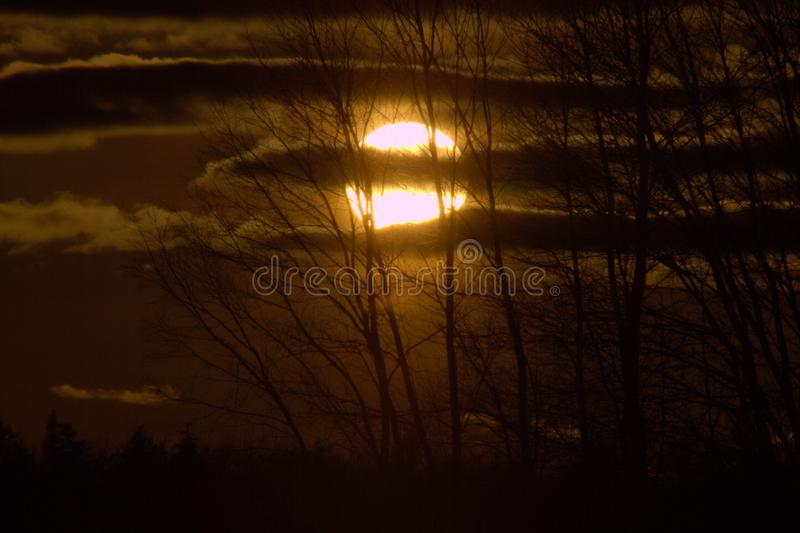 Setting autumn sun with clouds royalty free stock photos