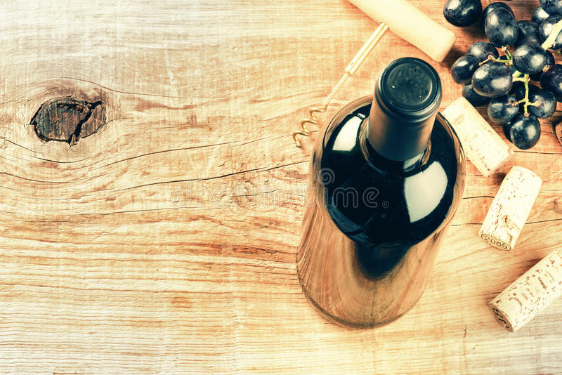 Setting with bottle of red wine, grape and corks with copy space royalty free stock image