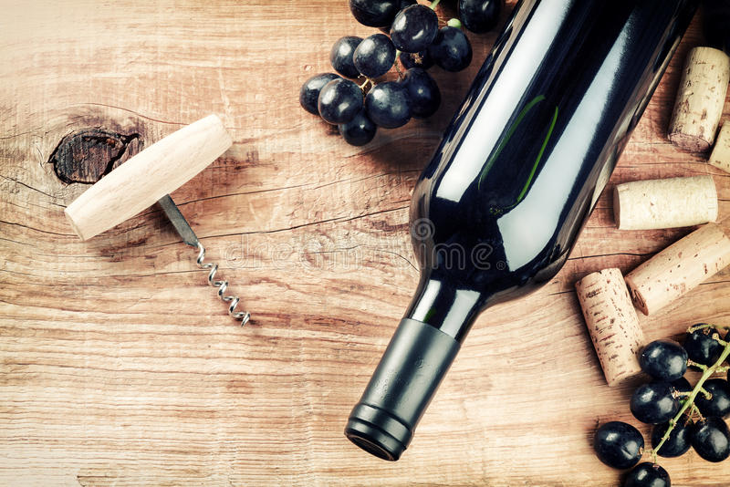 Setting with bottle of red wine, grape and corks. Wine list concept stock photos