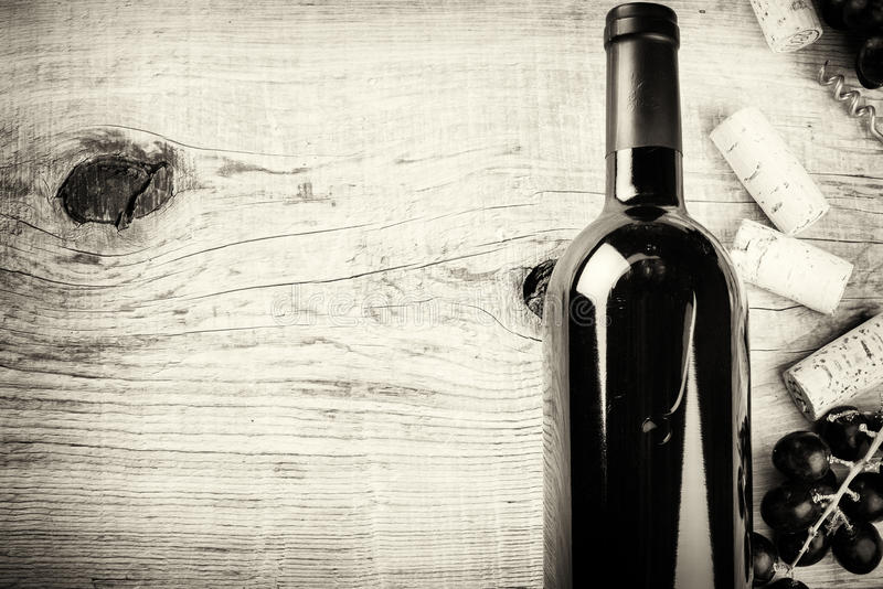 Setting with bottle of red wine, grape and corks. Wine list concept royalty free stock photos