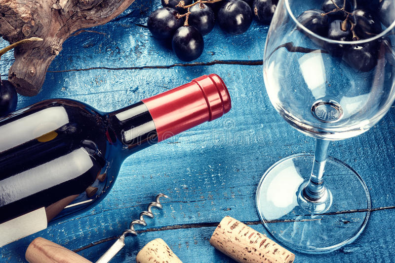 Setting with bottle of red wine, grape and corks. Wine list concept royalty free stock photography