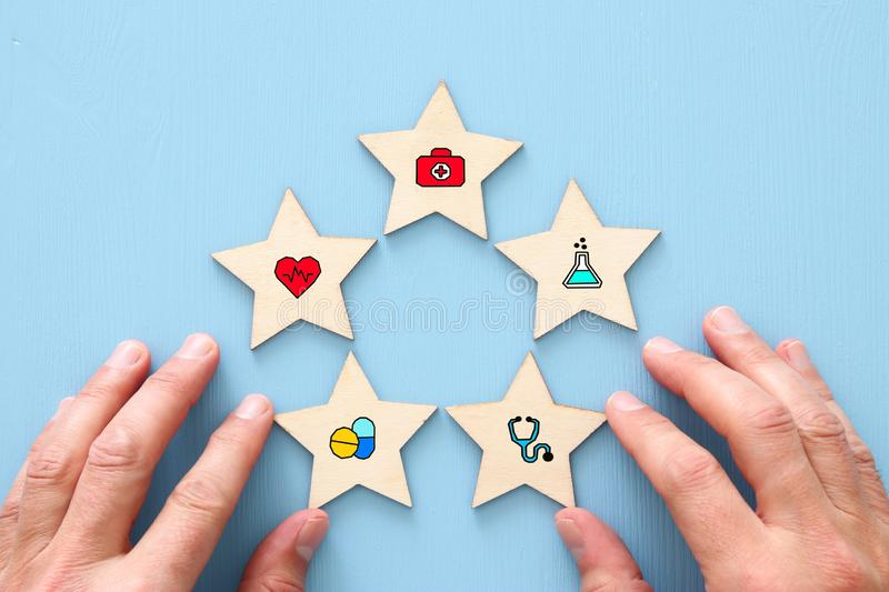 setting a five star medical service goal. healthcare and insurance concept. royalty free stock photos