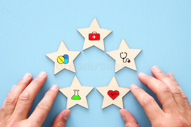 setting a five star medical service goal. healthcare and insurance concept. royalty free stock images