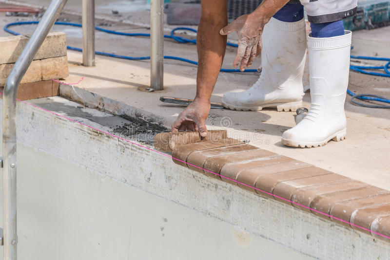 Setting new brick coping pool remodel stock photo image for Poolrand gestalten