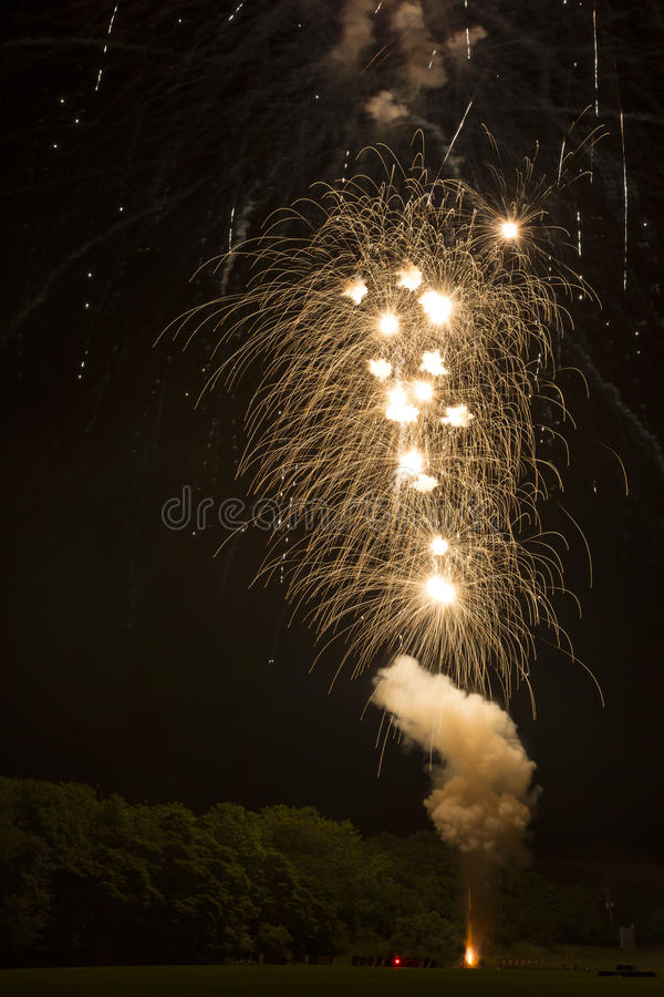 Setting Off Fireworks at Night: Up in a Puff of Smoke stock photography