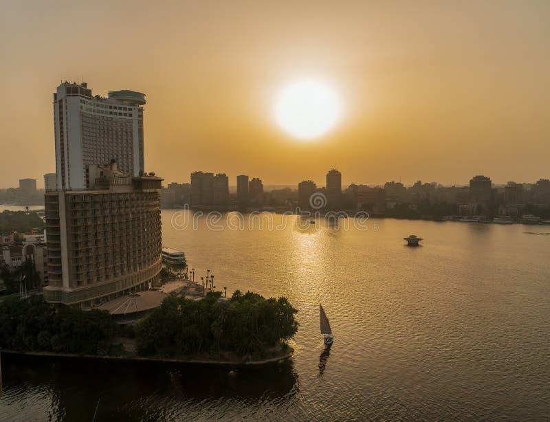 Setting Sun along the Nile River as it runs throught the city of Cairo, Egypt royalty free stock photos