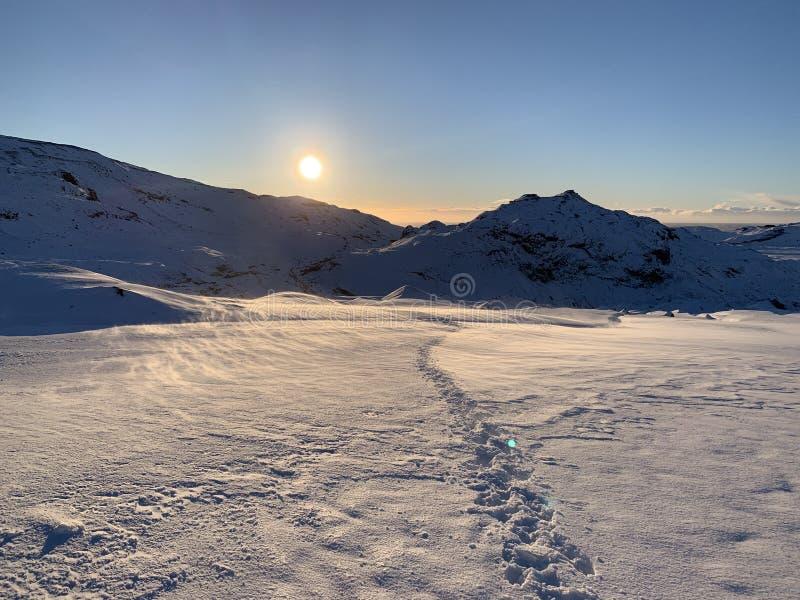 Setting sun on glacier stock photography