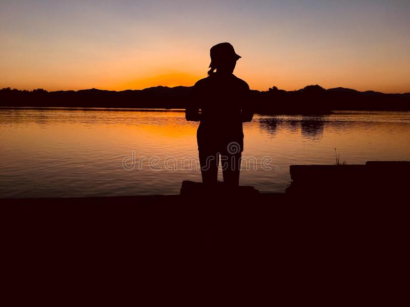 Sunset silhouette stock images