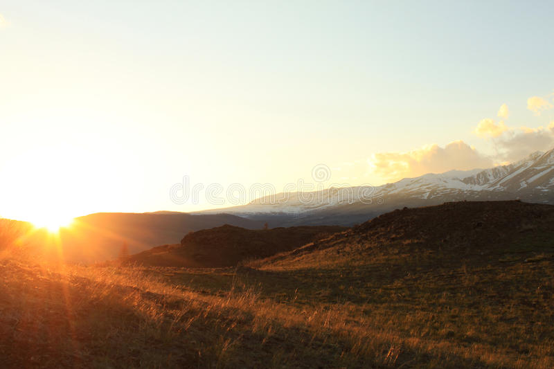 The setting sun in the Kurai steppe stock images