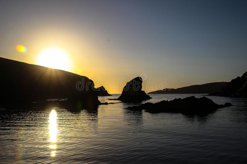 Setting sun at Peerie Spiggie. royalty free stock images