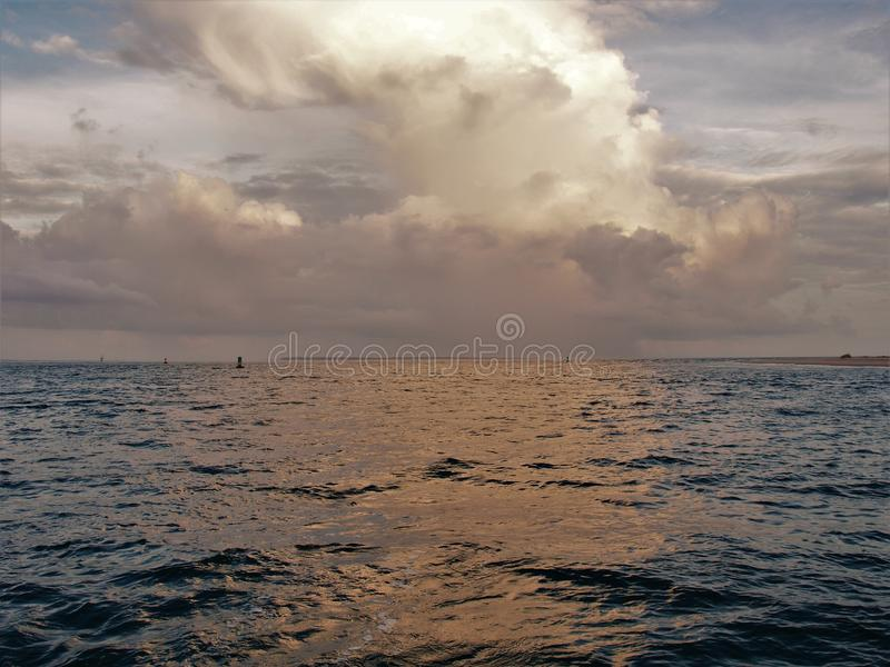 Clouds Reflecting off Water at Atlantic Beach. Setting sun shines off of clouds and reflects off the water in Atlantic Beach, North Carolina royalty free stock photo