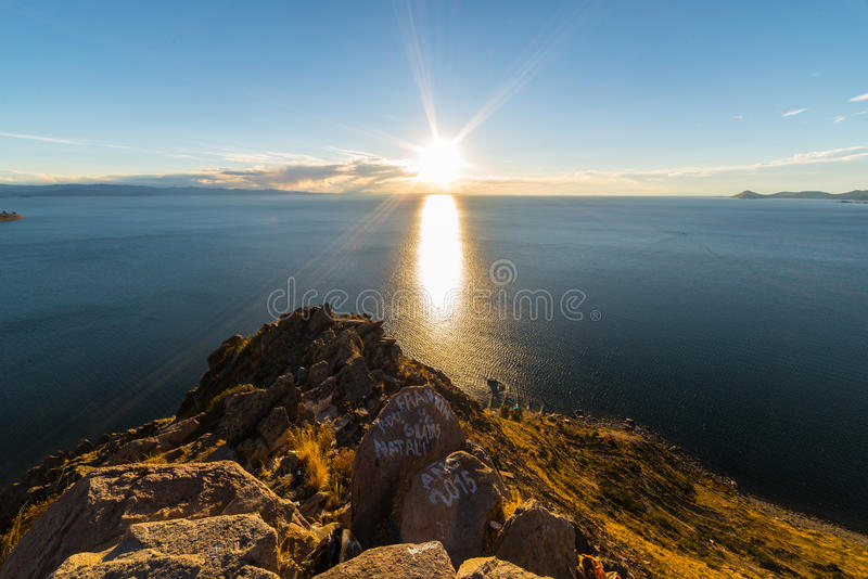 Setting sun on Titicaca Lake, Copacabana, Bolivia. Panoramic view of Titicaca Lake in backlight from the rocky headland of Mount Calvario (3966 m) in Copacabana royalty free stock photos