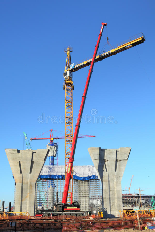 Setting tower crane in construction site royalty free stock image