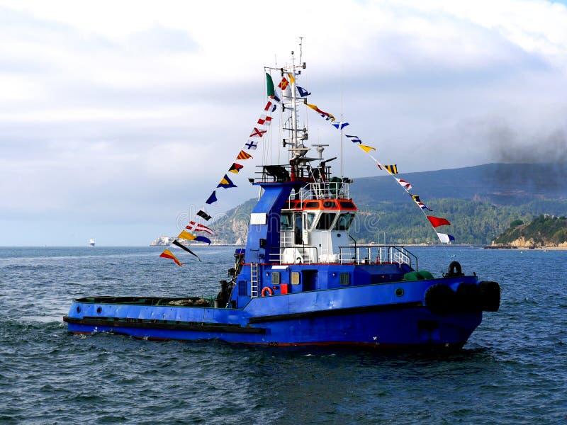 Tug Boat Maneuvering in Bay. royalty free stock photos