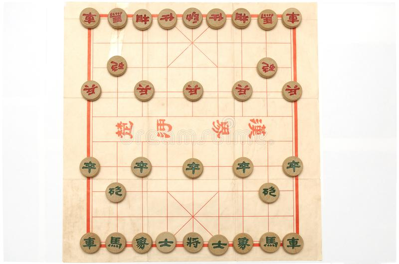 A setup of a game of chinese chess. A top down photo taken on the initial set up of a game of chinese chess against a white backdrop stock images