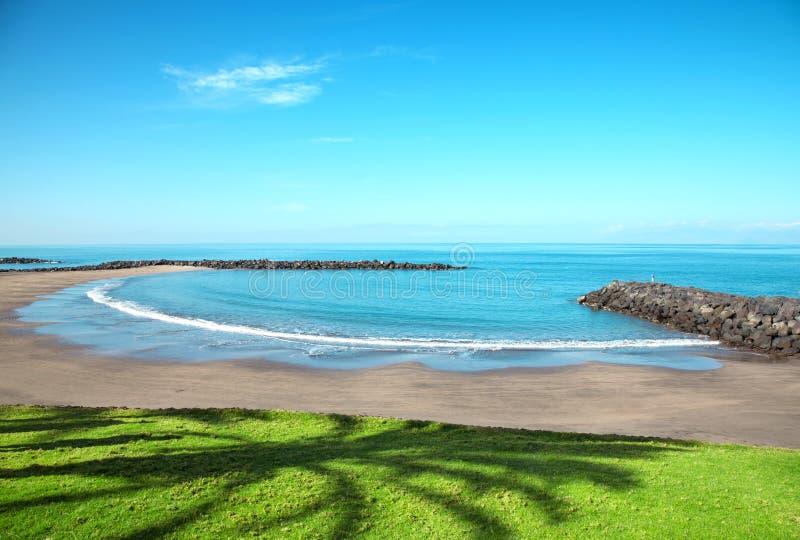 Setzen Sie in den Playa De las Amerika, Tenerife auf den Strand stockfotografie