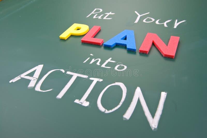 Setzen Sie Ihren Plan in die Tat um stockbild