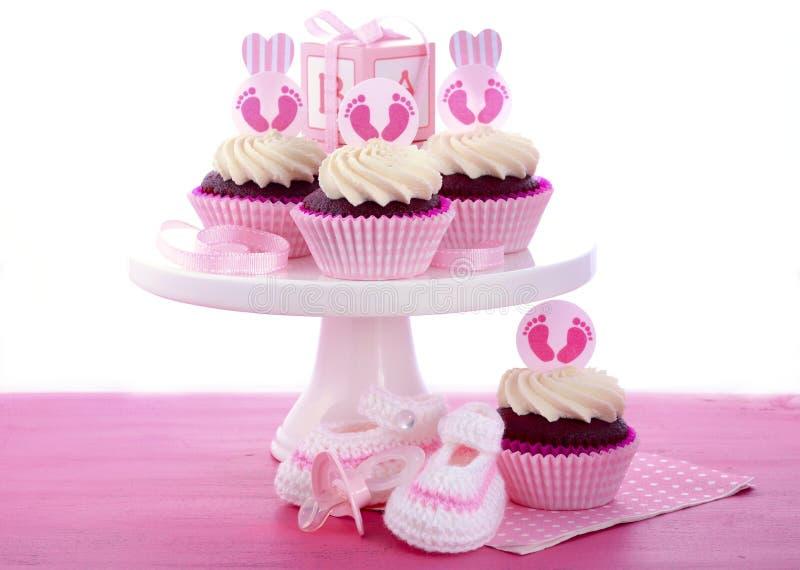 Seus queques de uma festa do bebê da menina imagem de stock royalty free