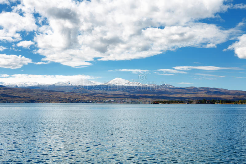 Sevan lake and white clouds blue sky on a sunny day, Armenia stock photos