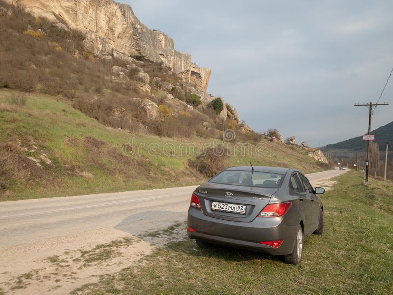 The car Hyundai Solaris is parked in nature. Giad Accent / Hyundai Avega / Hyundai Brio / Dodge Verna. Sevastopol, Republic of Crimea - March 23, 2019: The car royalty free stock photography