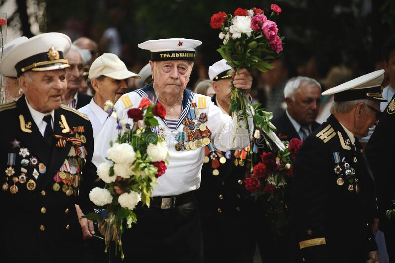 Sevastopol, Ukraine - May 9, 2012: Veterans of the Second World War with flowers at the parade during the celebration of `Victory. Day` over Nazi Germany stock images