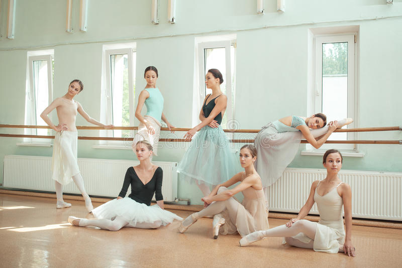 The seven ballerinas at ballet bar royalty free stock images