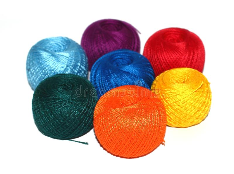 Seven balls of rainbow yarn stock image