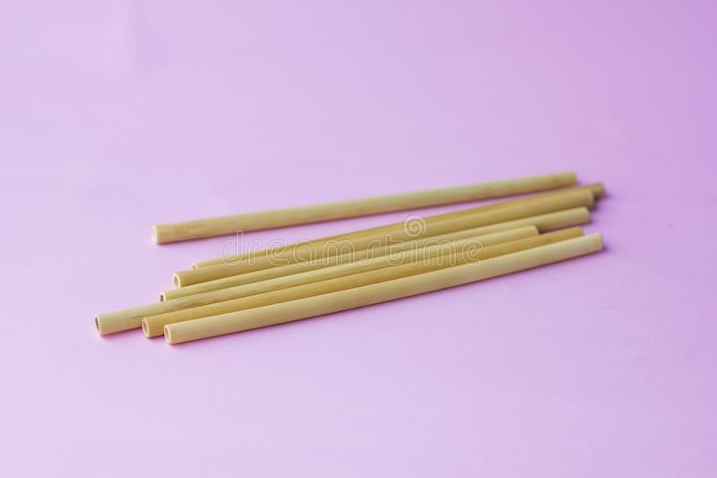 Seven bamboo straw lay on pink background stock image