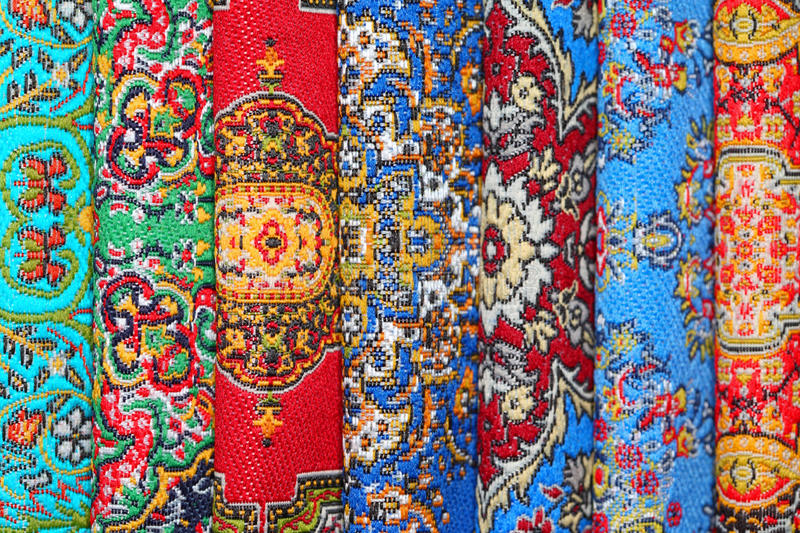 Download Seven Carpets Lie In Rouleau On Each Other Stock Photo - Image: 20698718
