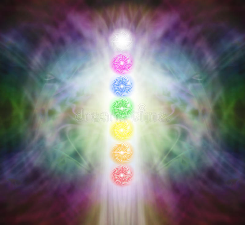 The Seven Chakra Vortexes in a Pranic Energy Field. Column of seven chakras on a beautiful ethereal energy formation background stock illustration