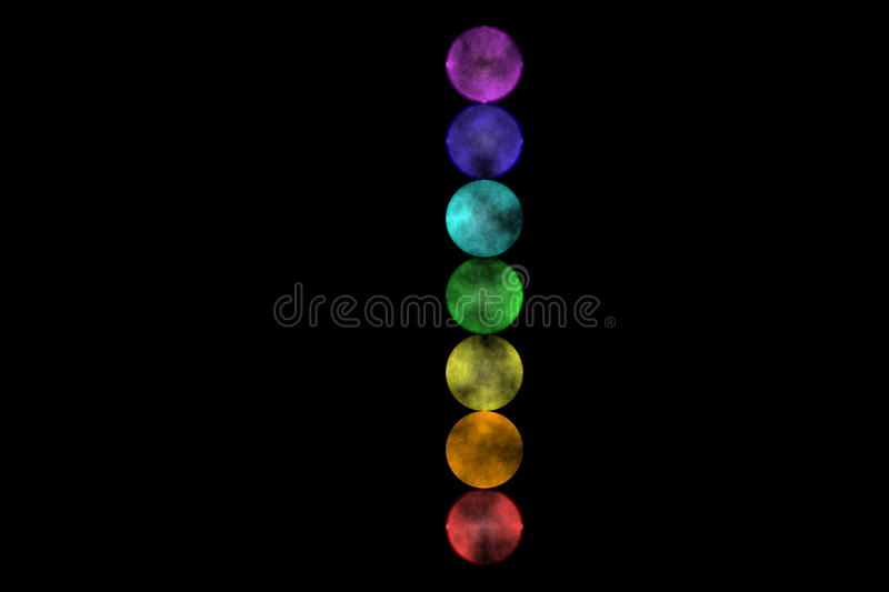 Seven Chakras. Illustration of the seven chakras on a black background royalty free illustration