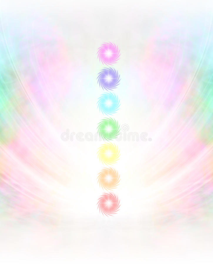 Seven Chakras in subtle energy field background. Symmetrical pastel colored wispy misty background with vertical row of seven chakras placed in center royalty free stock photo