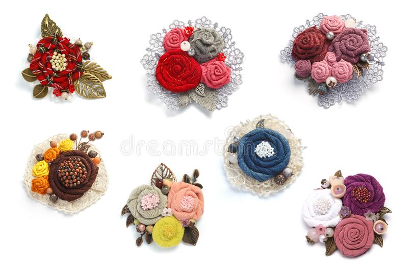 Seven charming female handmade decorations made from fabric on a white background stock images
