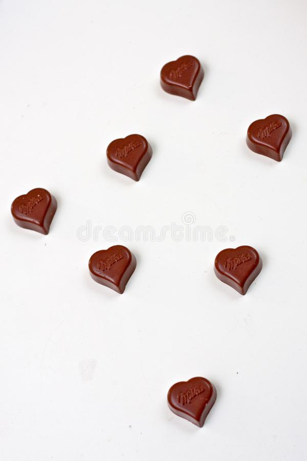 Seven chocolate hearts stock image