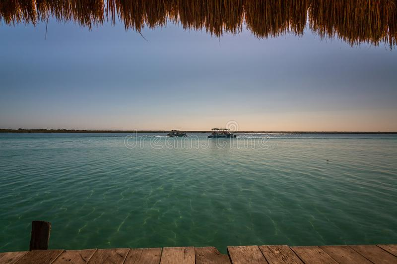 Seven Color Lagoon in Bacalar. Laguna de Bacalar is also known as the Lagoon of Seven Colors, in Bacalar, Mexico. The crystal clear waters and white sandy bottom royalty free stock photography