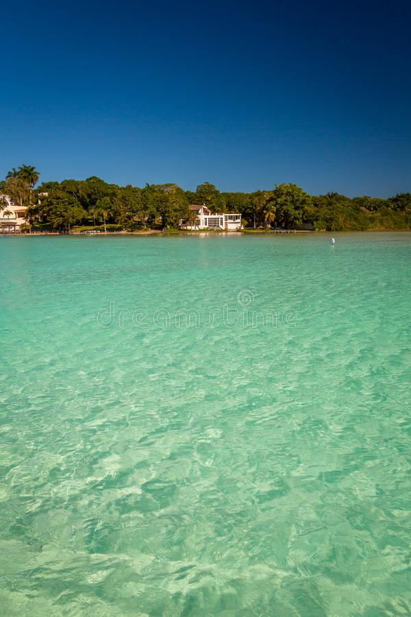Seven Color Lagoon in Bacalar. Laguna de Bacalar is also known as the Lagoon of Seven Colors, in Bacalar, Mexico. The crystal clear waters and white sandy bottom stock image