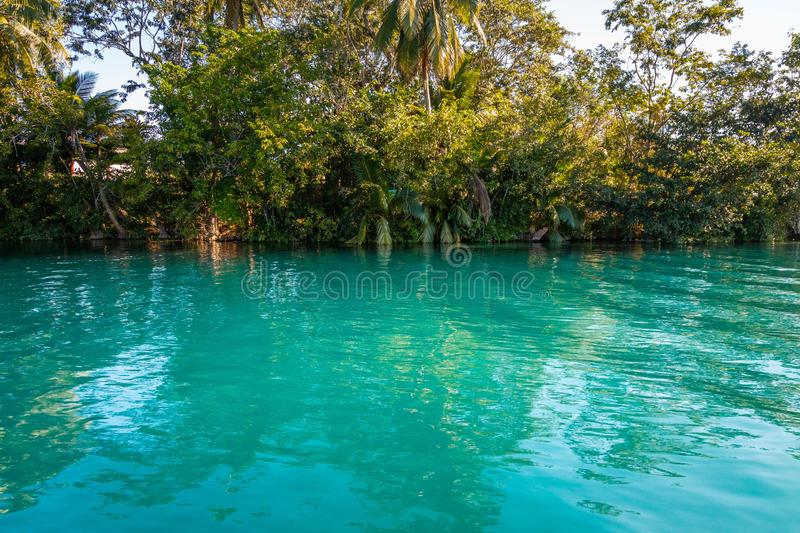 Seven Color Lagoon in Bacalar. Laguna de Bacalar is also known as the Lagoon of Seven Colors, in Bacalar, Mexico. The crystal clear waters and white sandy bottom stock photography