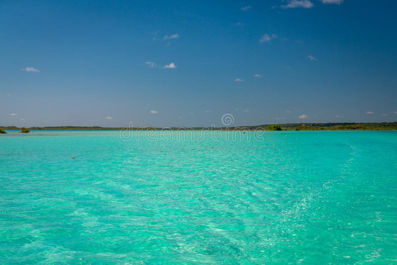 Seven Color Lagoon in Bacalar. Laguna de Bacalar is also known as the Lagoon of Seven Colors, in Bacalar, Mexico. The crystal clear waters and white sandy bottom royalty free stock photos