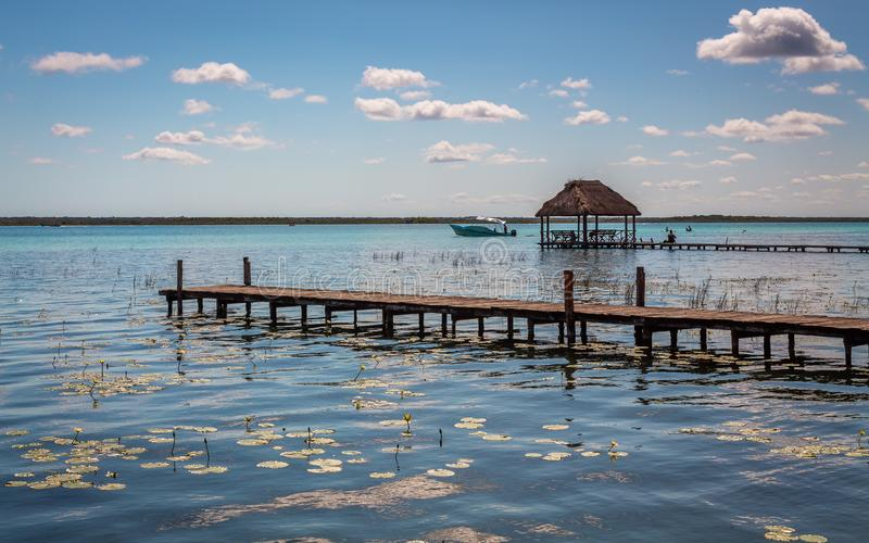 Seven Color Lagoon in Bacalar. Laguna de Bacalar is also known as the Lagoon of Seven Colors, in Bacalar, Mexico. The crystal clear waters and white sandy bottom stock images