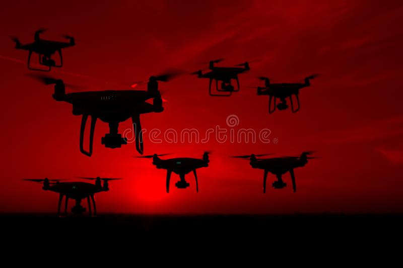 Silhouette of drones in the sky, red sunset royalty free stock photo