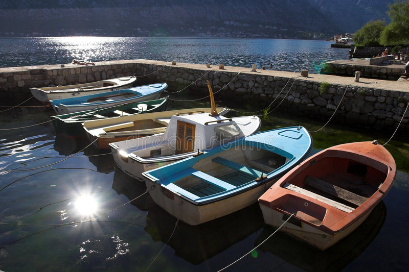 Seven fishing boats in harbor, Boka Kotorska bay. Kotor, Montenegro stock images