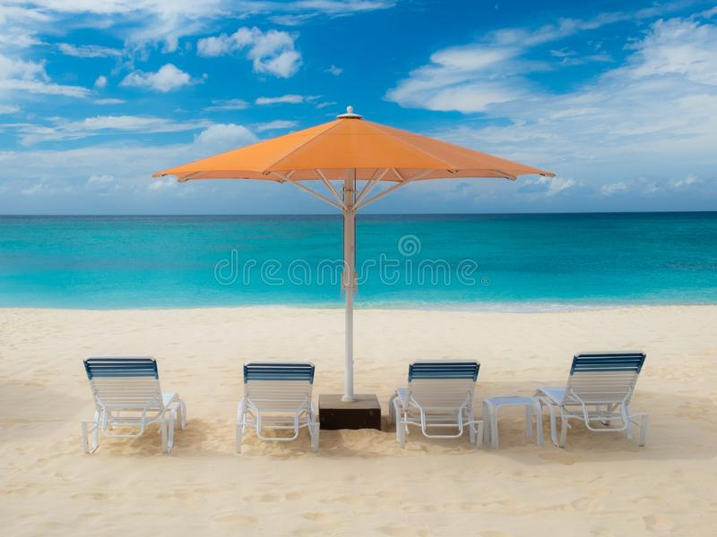 Seven Mile Beach-Parasol stock image