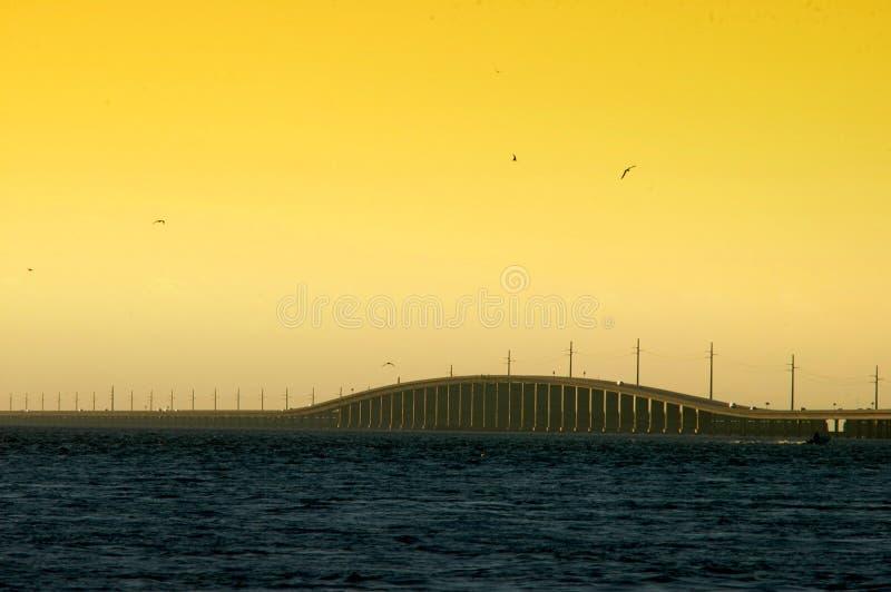 Seven mile bridge. 7 mile bridge with blue ocean and golden twilight sky as the sun sets stock photography
