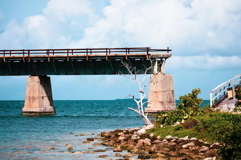 Seven Mile Bridge in Florida Keys. Piling support of abandoned and damaged Old Seven Mile Bridge railroad with landscape view in Florida Keys in Atlantic ocean royalty free stock photo
