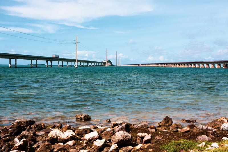 Seven Mile Bridge in Florida Keys. Piling support of abandoned and damaged Old Seven Mile Bridge railroad with landscape view in Florida Keys in Atlantic ocean royalty free stock images