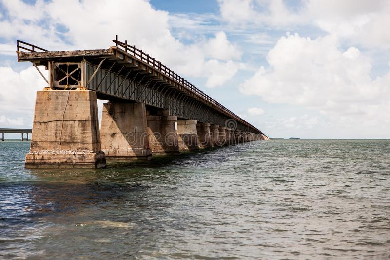 Seven Mile Bridge in Florida Keys. Piling support of abandoned and damaged Old Seven Mile Bridge railroad with landscape view in Florida Keys in Atlantic ocean stock images