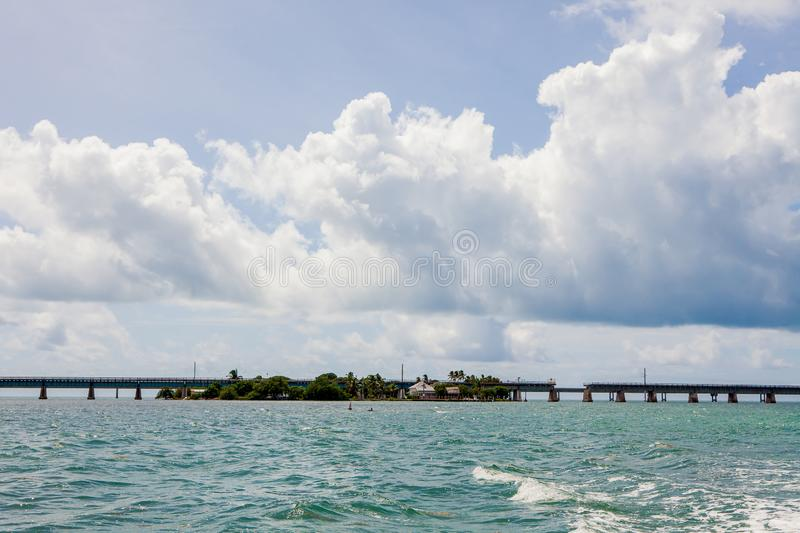 Seven Mile Bridge in Florida Keys. Piling support of abandoned and damaged Old Seven Mile Bridge railroad with landscape view in Florida Keys in Atlantic ocean stock photos
