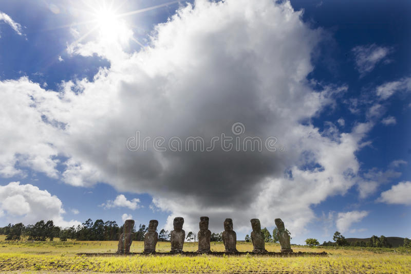 Seven Moais with huge cloud behind stock photography