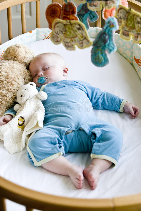 Download Seven Month Old Baby Boy Sound Asleep In His Crib Stock Image - Image: 10749331