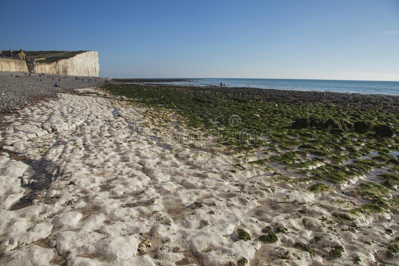 Seven Sisters and Beachy Head cliffs, England, the UK - chalk rocks on the beach and blue skies. This image shows a view of Seven Sisters and Beachy Head cliffs royalty free stock photos